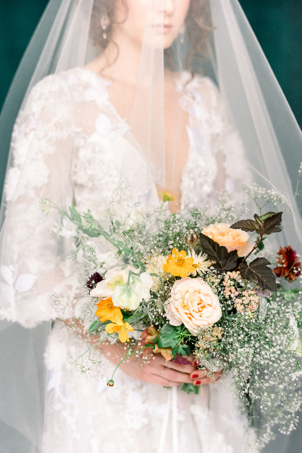 Flower Scout baby's breath bouquet and marchesa wedding gown
