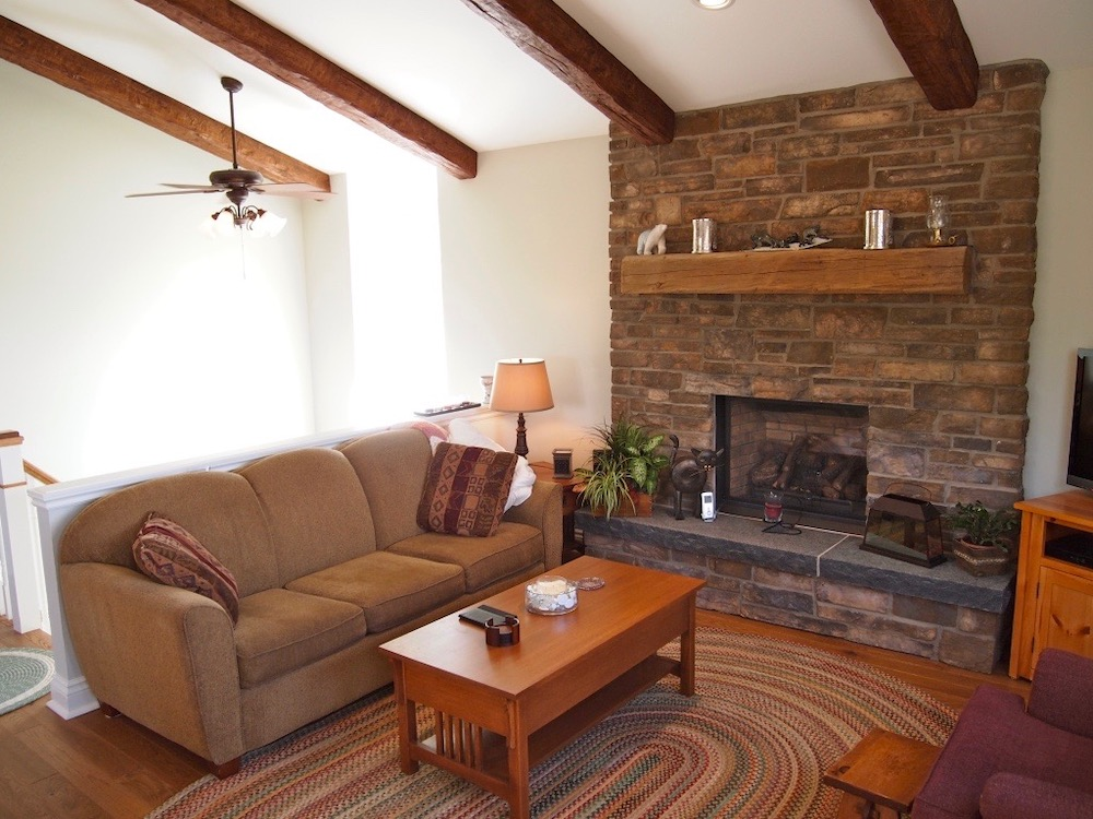 cathedral vaulted ceiling timber beams fireplace.jpeg