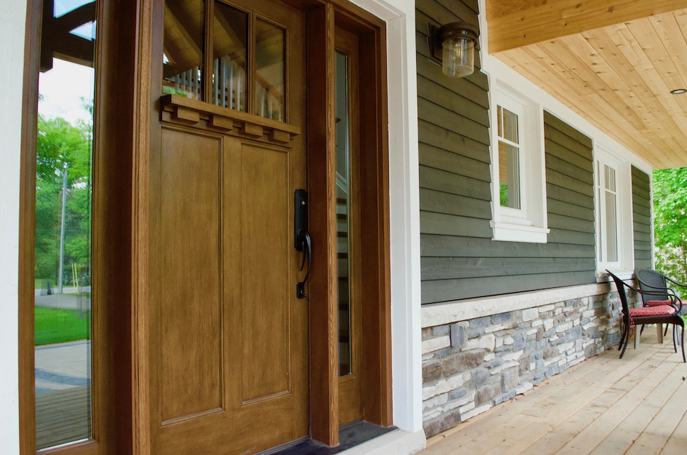 craftsman entry door oak verandah blue board and batten stone skirt.jpeg