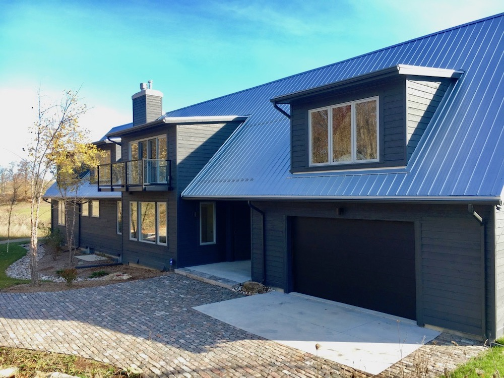 custom home cape cod charcoal steel roof modern.jpeg