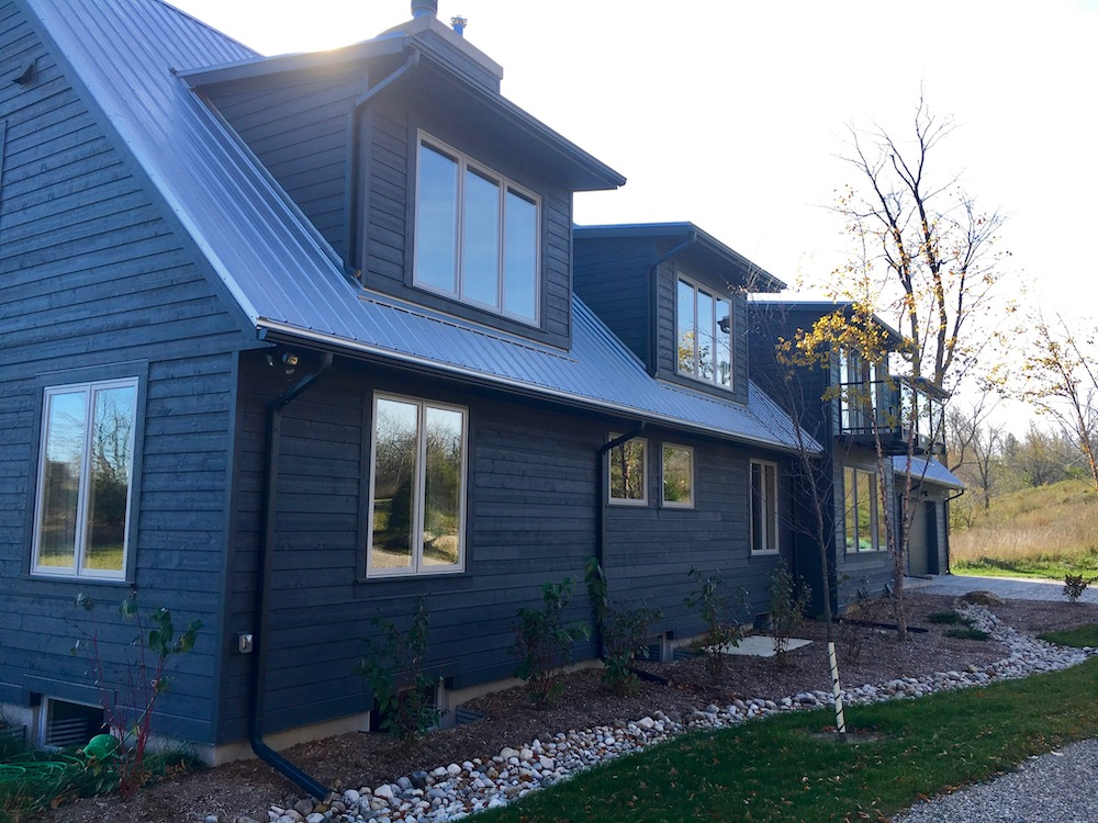 custom home charcoal cape cod siding modern steel roof.jpeg
