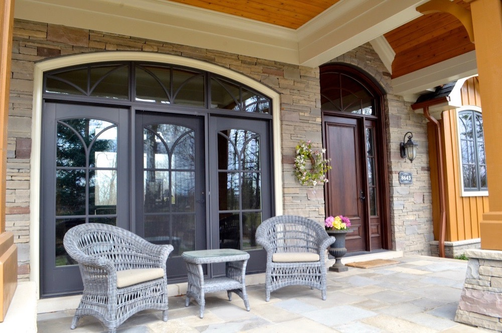 custom home entry porch covered arched top door.jpeg
