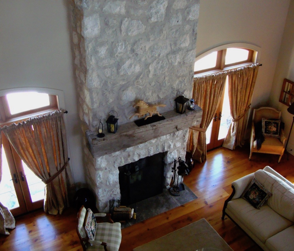 custom home stone fireplace timber mantel.jpeg