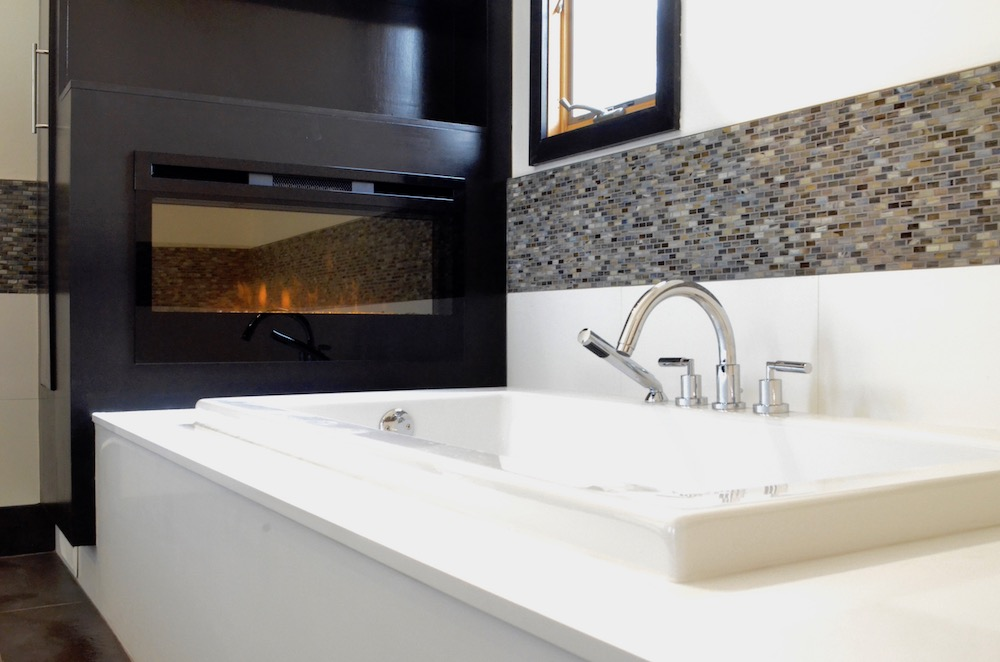 ensuite bathroom tub fireplace tile.jpeg