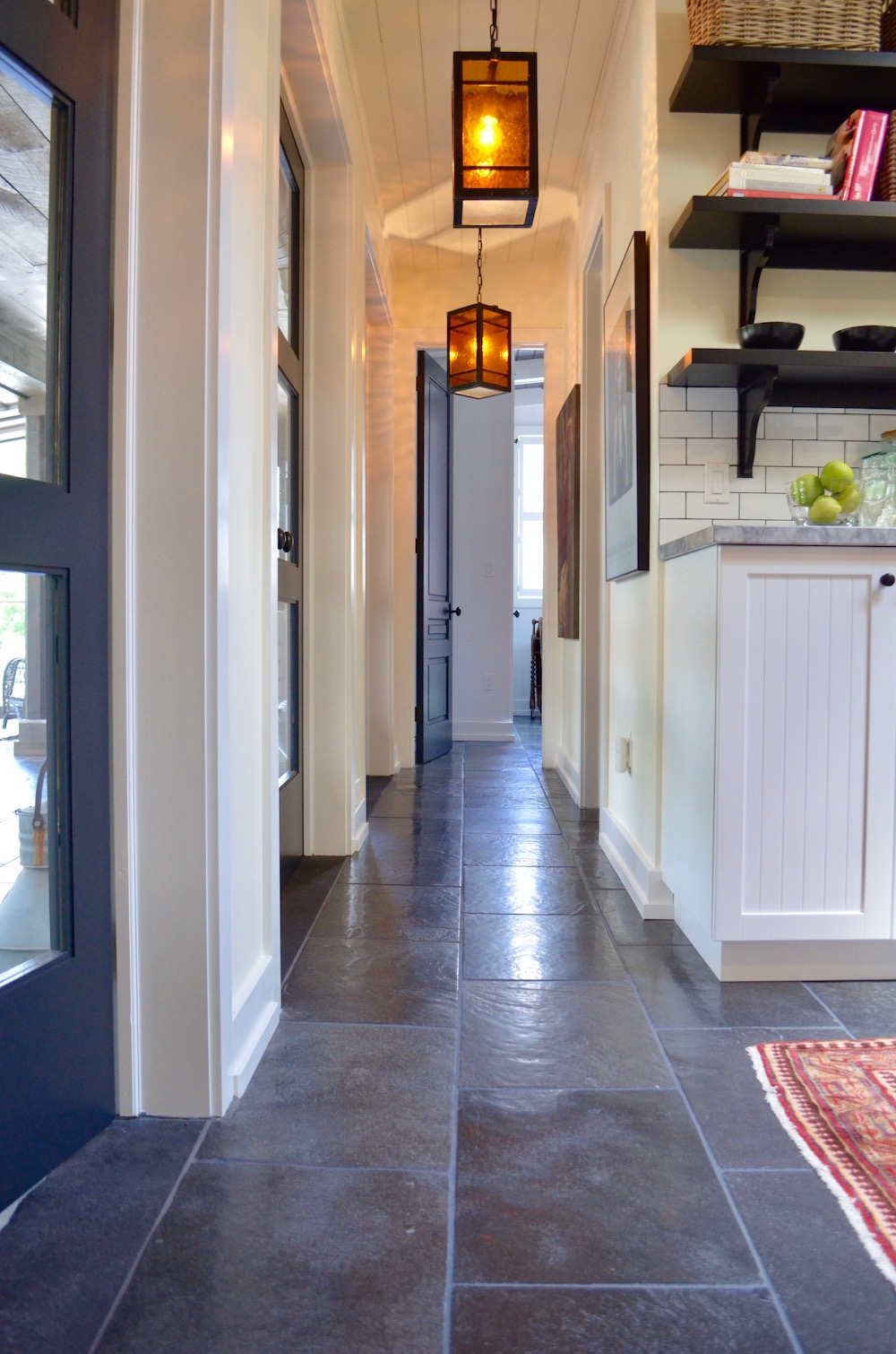 farmhouse slate floor white kitchen.jpeg