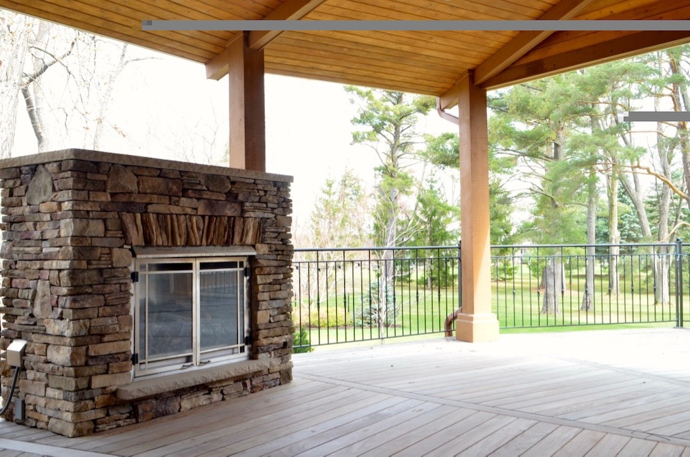 ipe deck segmented outside exterior fireplace tongue and groove cedar ceiling.jpeg