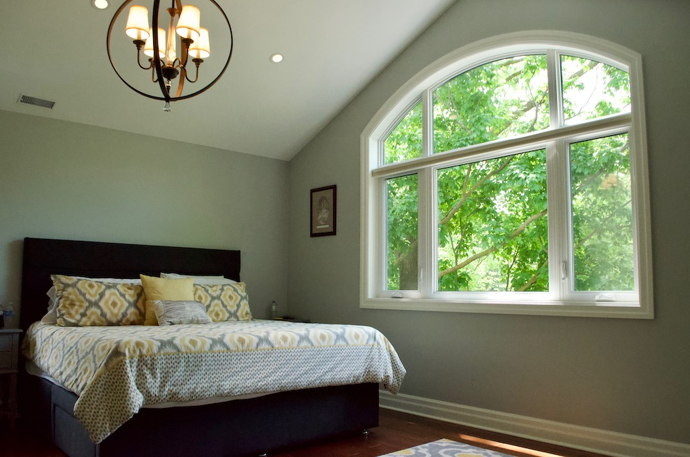 master bedroom arched top window cathedral vaulted ceiling.jpeg