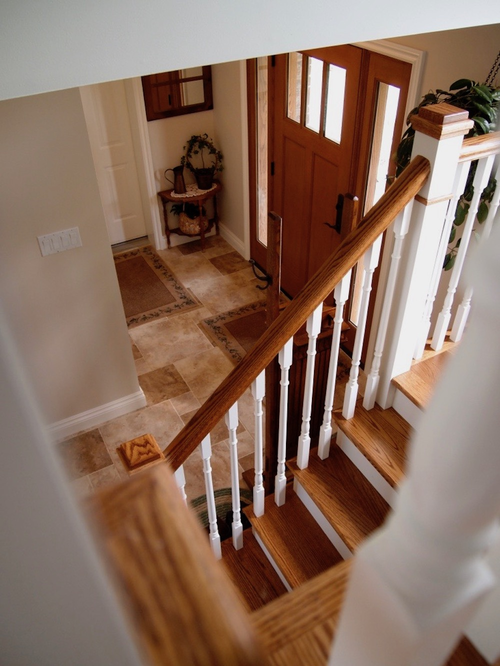 oak stair white pickets craftsman door.jpeg