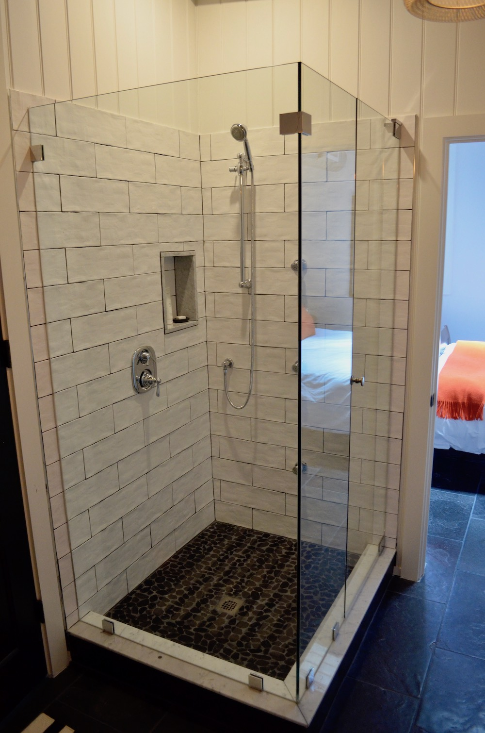 shower tile glass enclosure black floor.jpeg