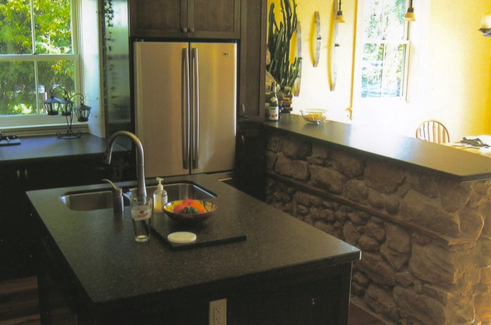 stone wall kitchen renovation.jpeg