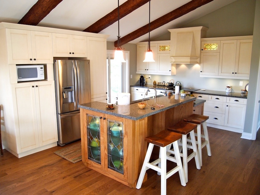 vaulted cathedral ceiling timber beams white kitchen isalnd.jpeg