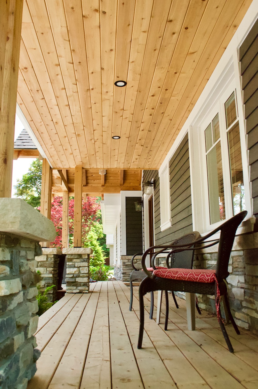 verandah cedar tongue and groove blue cape cod siding stone skirt.jpeg