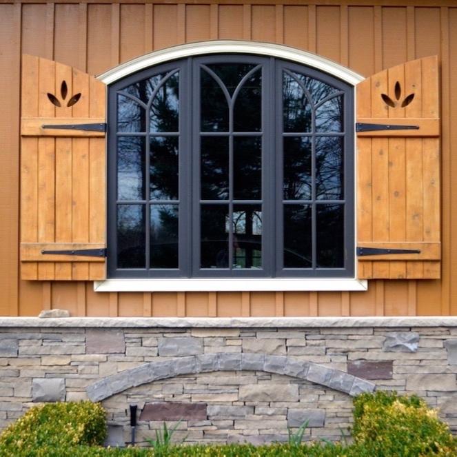 custom+home+board+and+batten+shutters+cedar+arched+top+window+stone+skirt.jpg