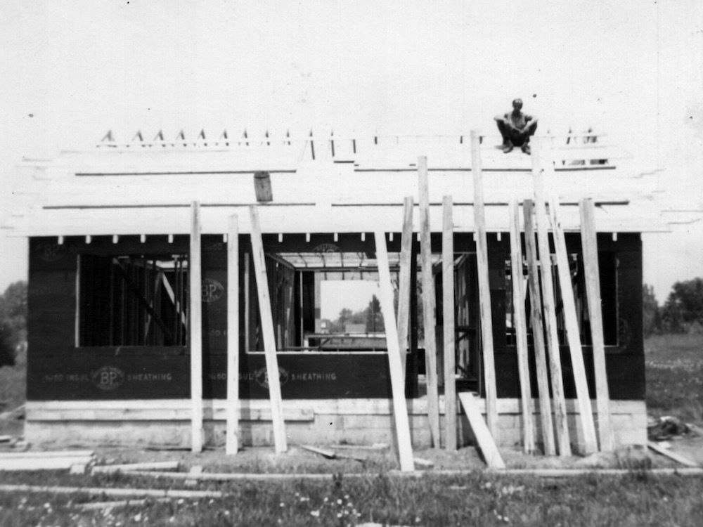 jack vandenberg on roof framing building.jpeg