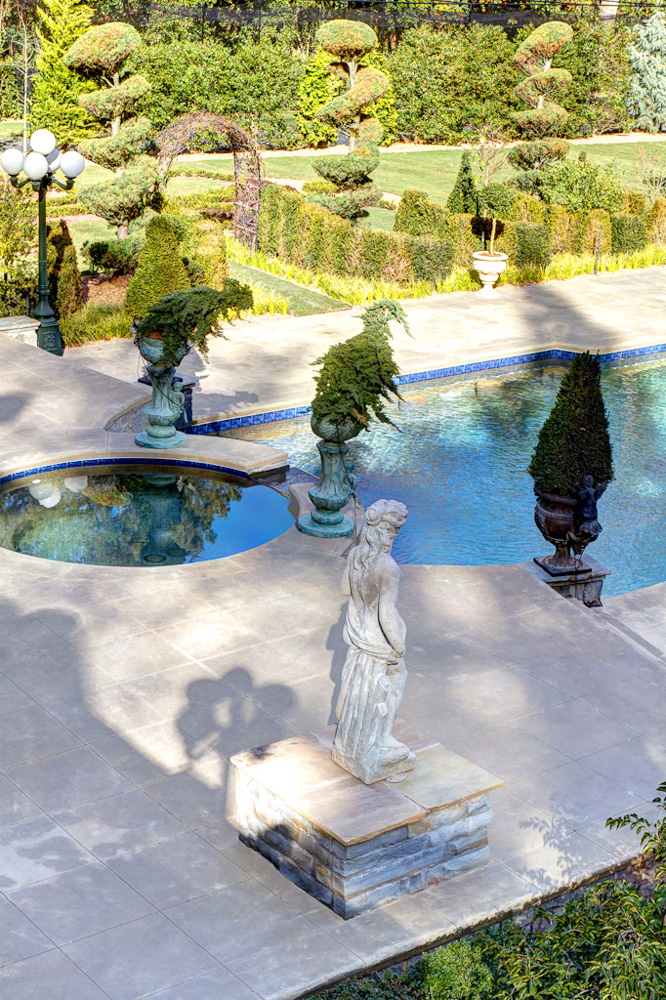 pool hot tub sculpture and planters.jpg