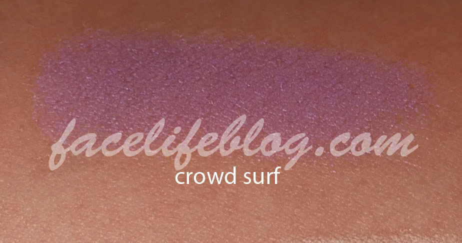 Crowd Surf is a gorgeous shade of violet shimmer. It appears a little more violet when it's sheer (shown) but becomes a beautiful Mardi Gras purple when you build it.