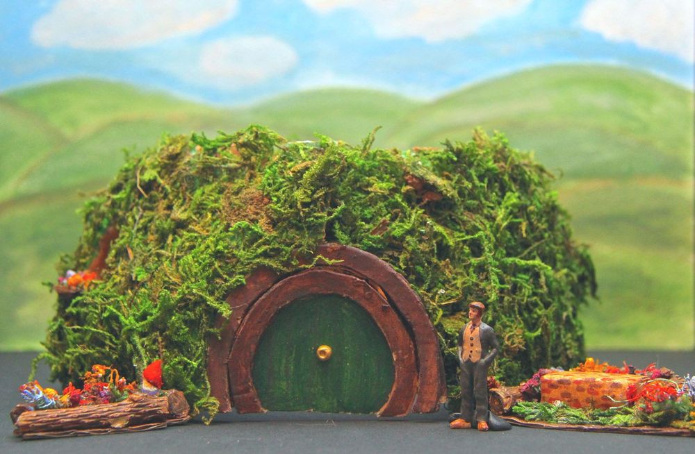 The Hobbit : Exterior of Bag End, Theoretical Design, Texas UIL State Meet, 2013  This design was for the Texas UIL 2013 competition. The house later swings open to reveal the interior when the dwarves begin to take over Bilbo's house.I was a state finalist.