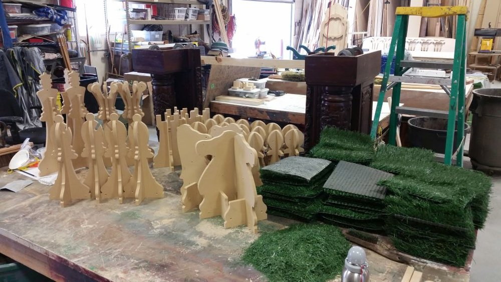 The Three Musketeers : Lawn Chess Game (in process), Utah Shakespeare Festival, 2016  I assembled the chess pieces and cut 64 squares of Astroturf, and then trimmed the grass on half of them by hand to create a chessboard effect