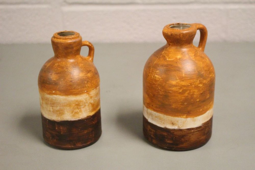 Pirates of Penzance : Drinking Jugs.  I made several drinking jugs using various syrup containers.