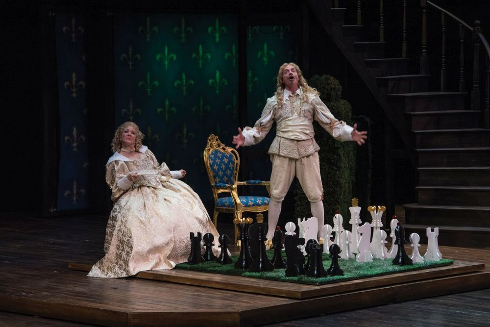 The Three Musketeers : Lawn Chess Game (in production), Utah Shakespeare Festival, 2016  Kim Martin-Cotten (left) as Queen Anne and Ben Livingston as King Louis XIII.(Photo by Karl Hugh. Copyright Utah Shakespeare Festival 2016.)