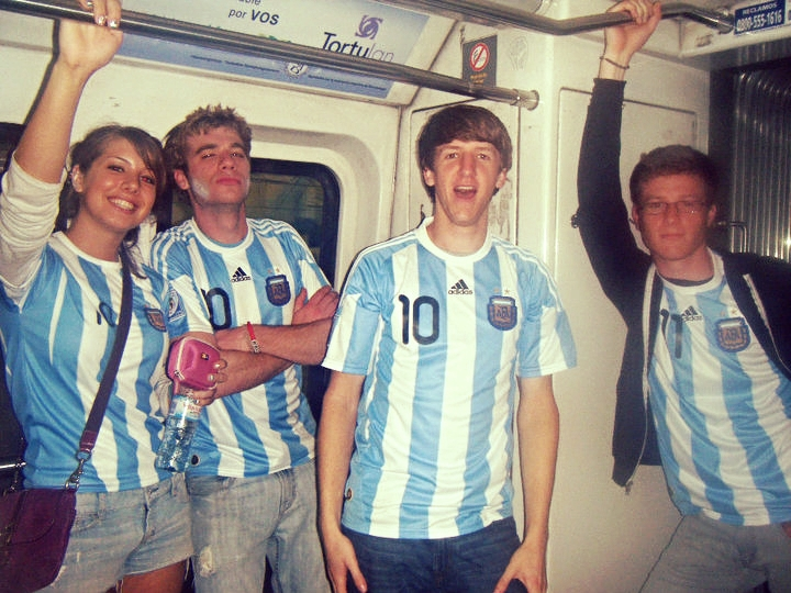 How to blend in and not look like a tourist in Argentina.  Buenos Aires Subte, World Cup Quarterfinals Game Day, July 2010.  Michael is on the right, doing his best Abercrombie pose.  Yours truly is on the center left with Argentine flags painted on his face.  An example of flawless assimilation