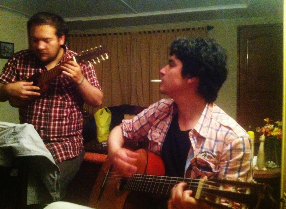 """Oscar and our friend """"Pelado"""" playing at a party at Pelado's girlfriend's house. Either Chileans are very musical people or I just happened to meet the ones who like to play music the most"""