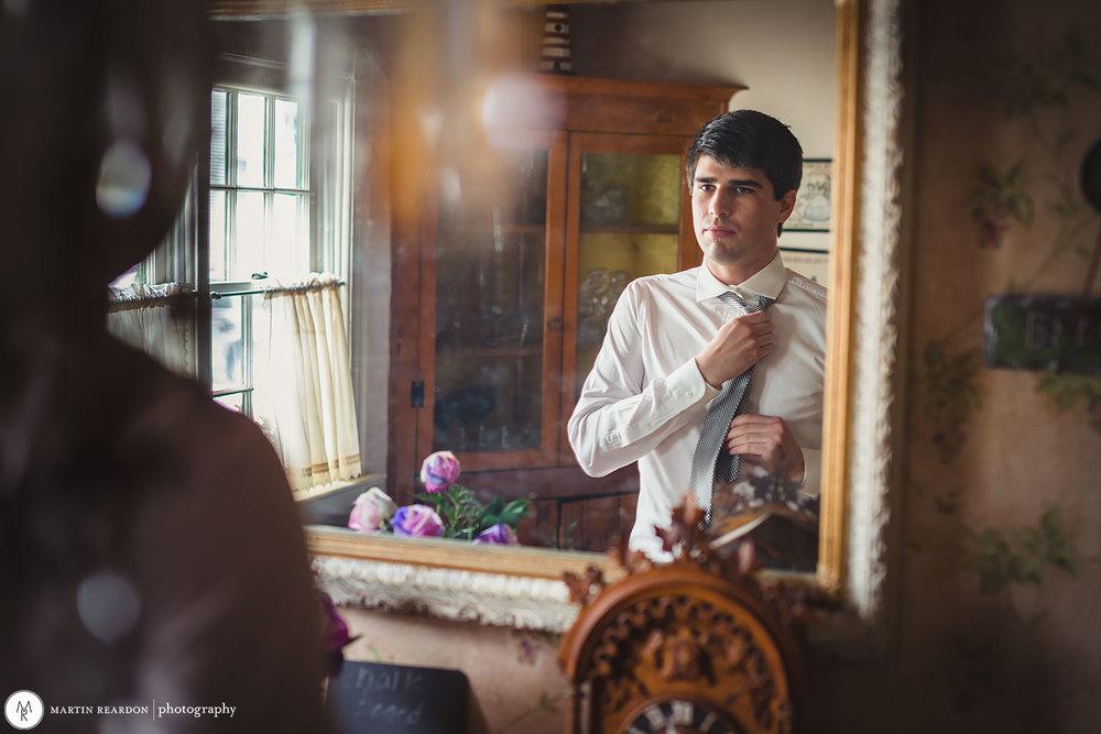 2-Groom-Getting-Dressed-In-Mirror.jpg