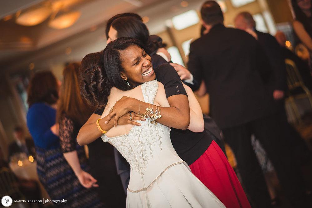 17-wedding-reception-hug-bride.jpg