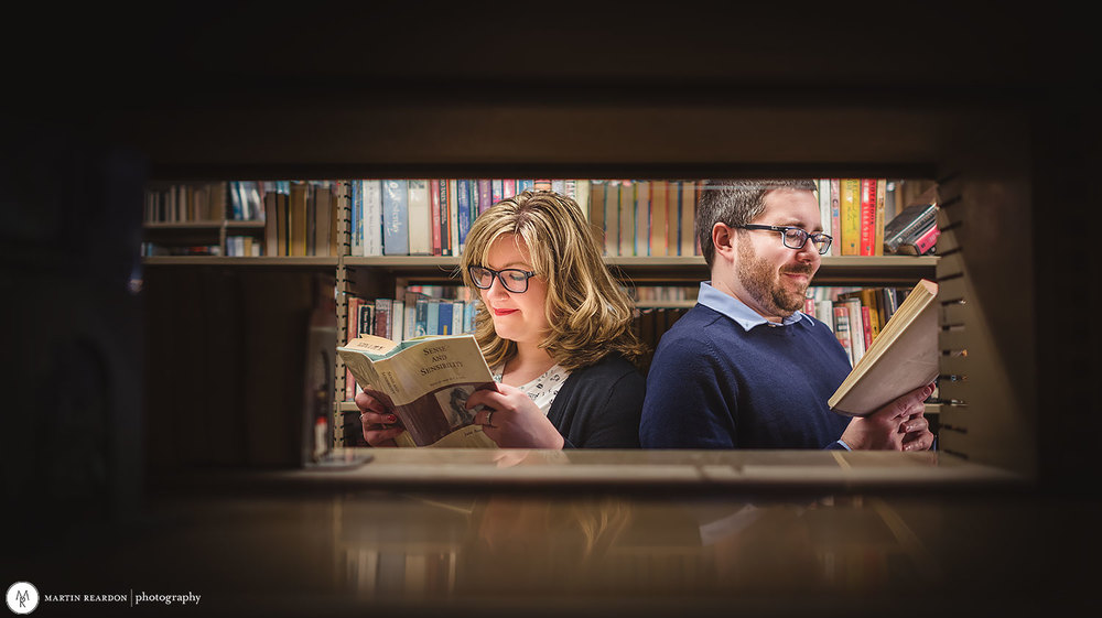 Engagement-shoot-couple-in-library.jpg