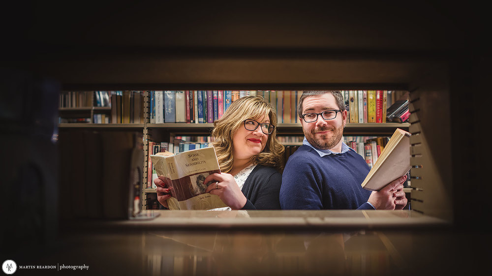 Engagement-shoot-couple-in-library-looking-back.jpg