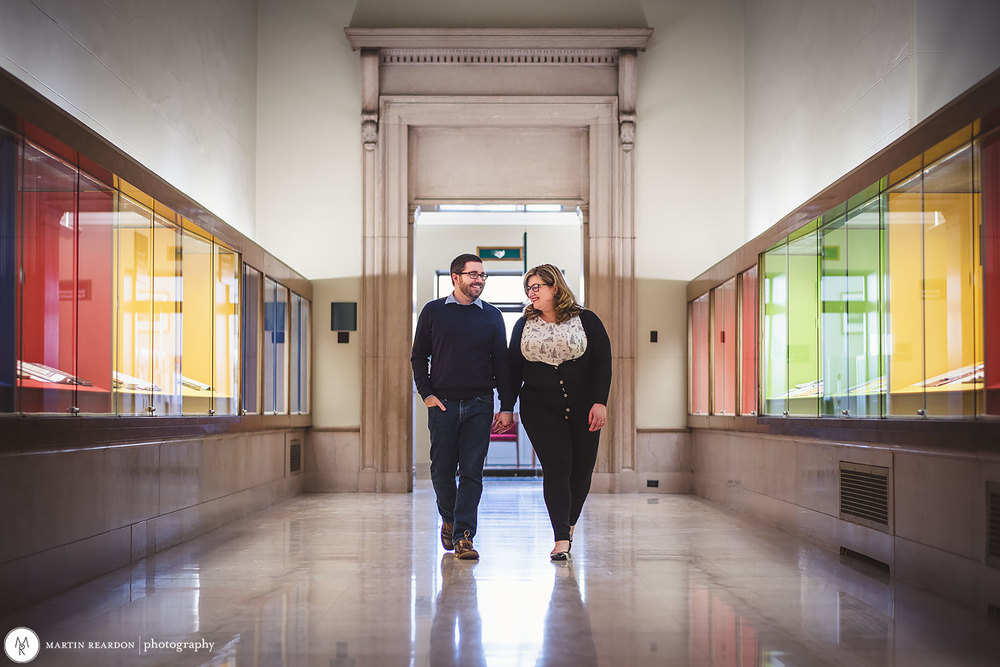 Engagement-shoot-couple-in-library-walking.jpg