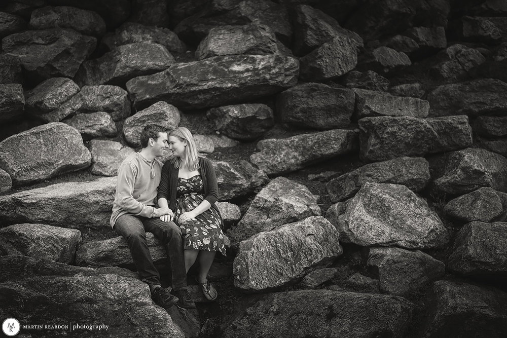 engagement photo couple sitting on rocks at Philadelphia Art Museum
