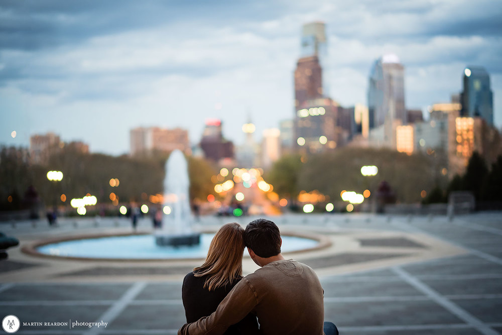 engagement photo couple looking at Philadelphia