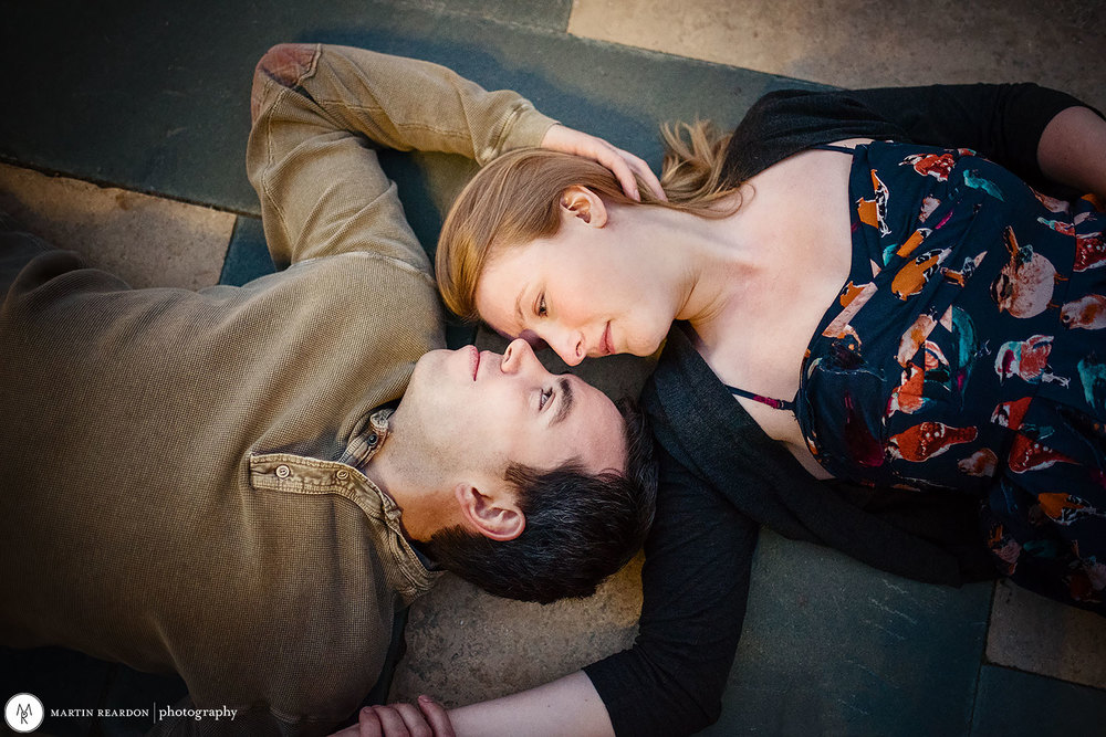 Engagement photo. couple laying on ground at Philadelphia Art Museum