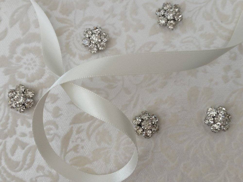 Stephanie - floral paper, ivory satin ribbon, crystal cluster.jpg