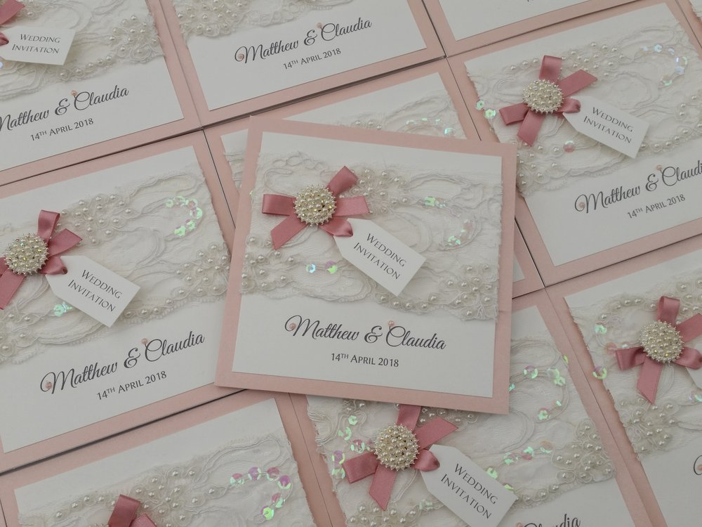 Claudia - pocketfold wedding invitation with pearl lace, pearl cluster embellishment, dusky pink bow and tag2.jpg