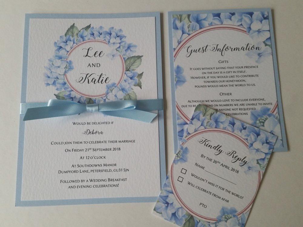Katie & Lee - wedding invitations rustic pale blue floral wreath ribbon .jpg
