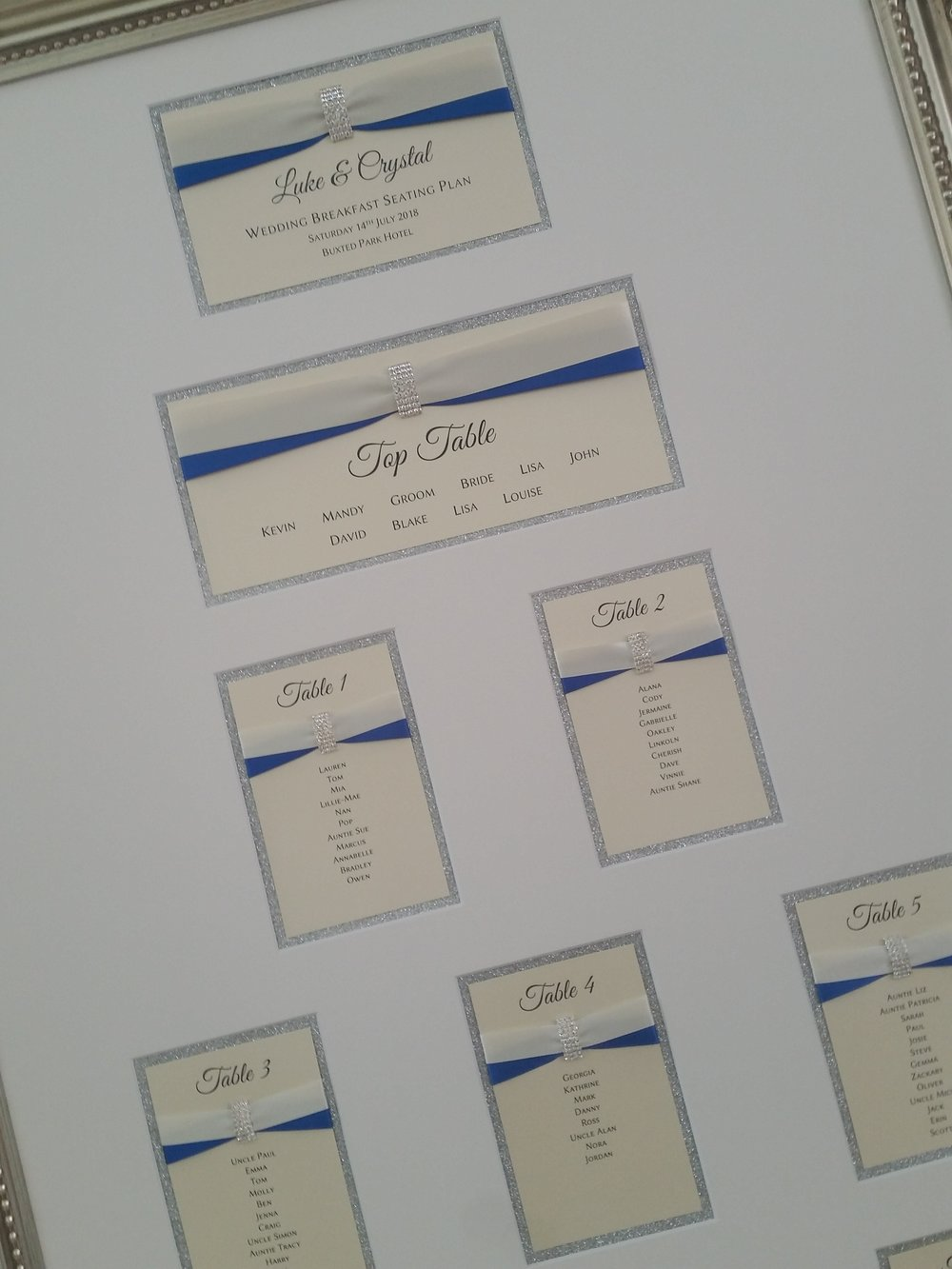 Crystal - handmade table plan, silver glitter, ivory and blue ribbon, crystal buckle.jpg