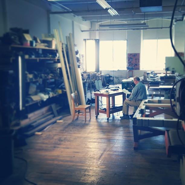 Mr. Hatch studying his notes amongst Kelvin mayhem. #filmmaking #scottbarberfilm #kinoflo