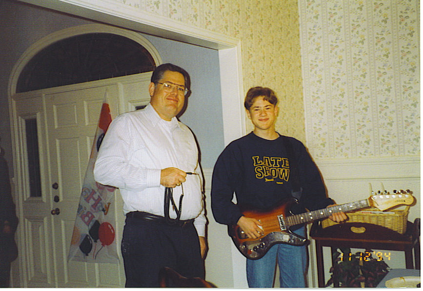 Hollis Webb, Jr. and Hollis Webb III with Deluxe Astrotone electric guitar, November 1994