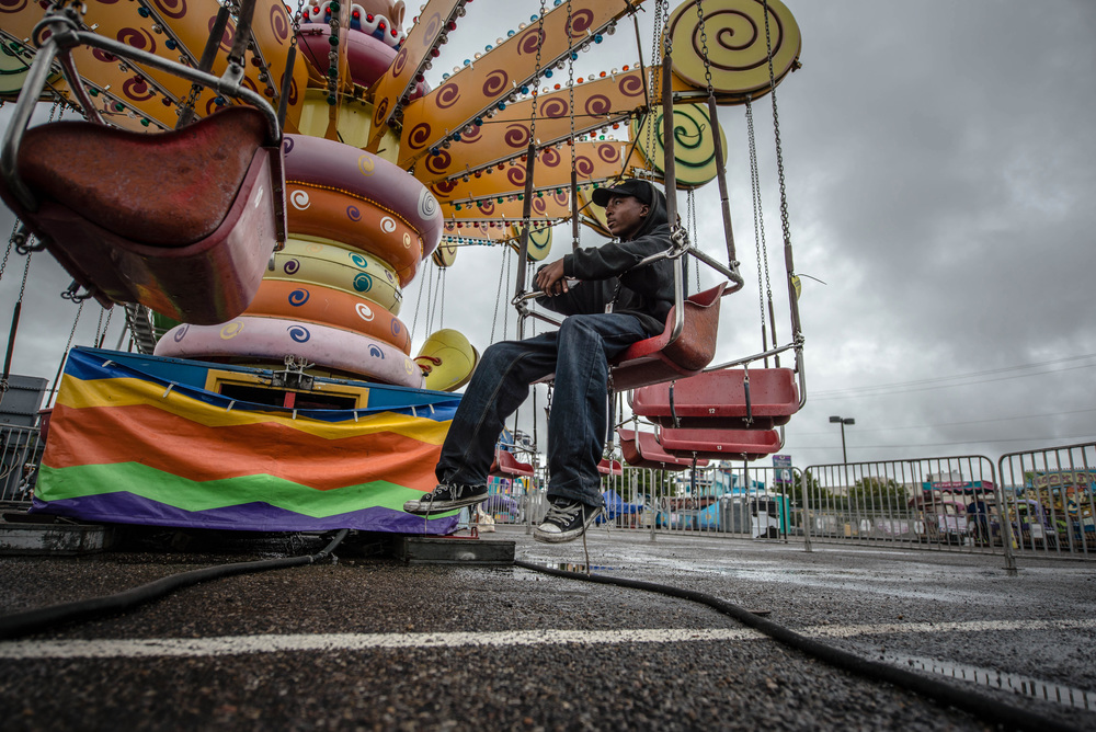 A ride operator waits for customers at the New Mexico State Fair