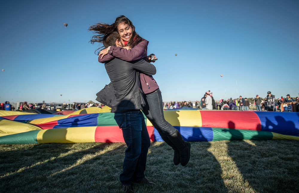 a couple celebrates after becoming engaged at the fiesta