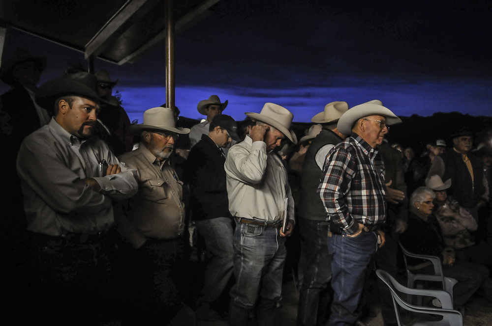 Ranchers meeting after one of their own is shot by a drug smuggler.