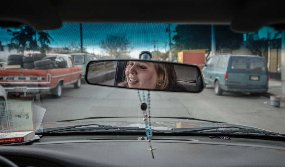 Emily Cruz drives to pick up her husband, Raymundo, at his job at a maquila where he builds harnesses for a global automotive supplier manufacturer for less than $50 a week. (Roberto E. Rosales/Albuquerque Journal)