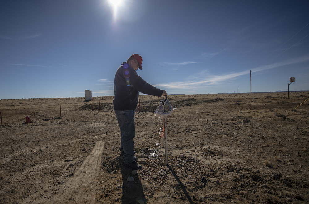 Chee Smith Jr., chapter president at Whitehorse Lake on the Navajo Nation, tests a new water line extended last month to the home he shares with his father in the remote, water-starved community. (Roberto E. Rosales/Albuquerque Journal