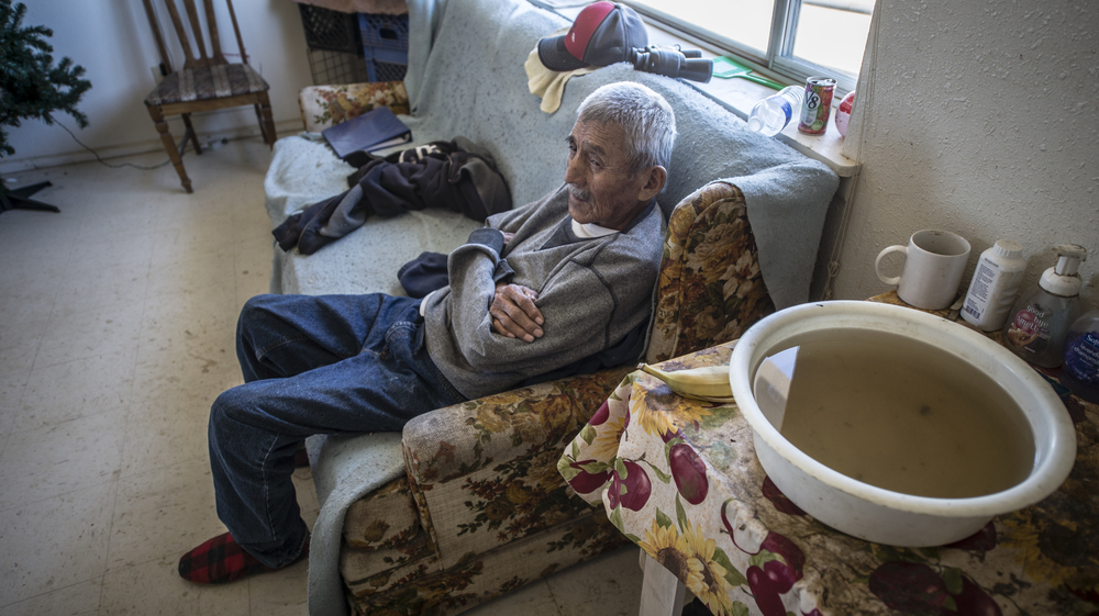 A bowl of water and hand soap are fixtures in homes like those of 87-year-old Chee Smith Sr. at Whitehorse Lake, where indoor plumbing is arriving for the first time in the Navajo Nation community. (Roberto E. Rosales/Albuquerque Journal)