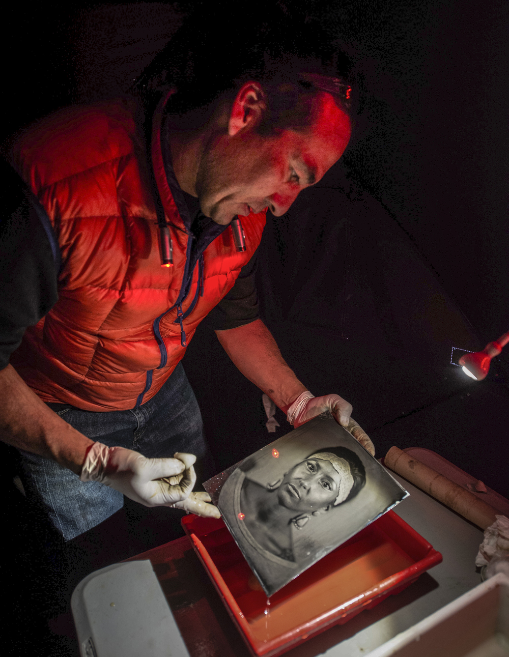 William Wilson develops a tintype as part of his collection of Native American portraits. (Roberto E. Rosales/Albuquerque Journal)  Wilson's work will be on display at the  Maxwell Museum at UNM   through Jan. 31