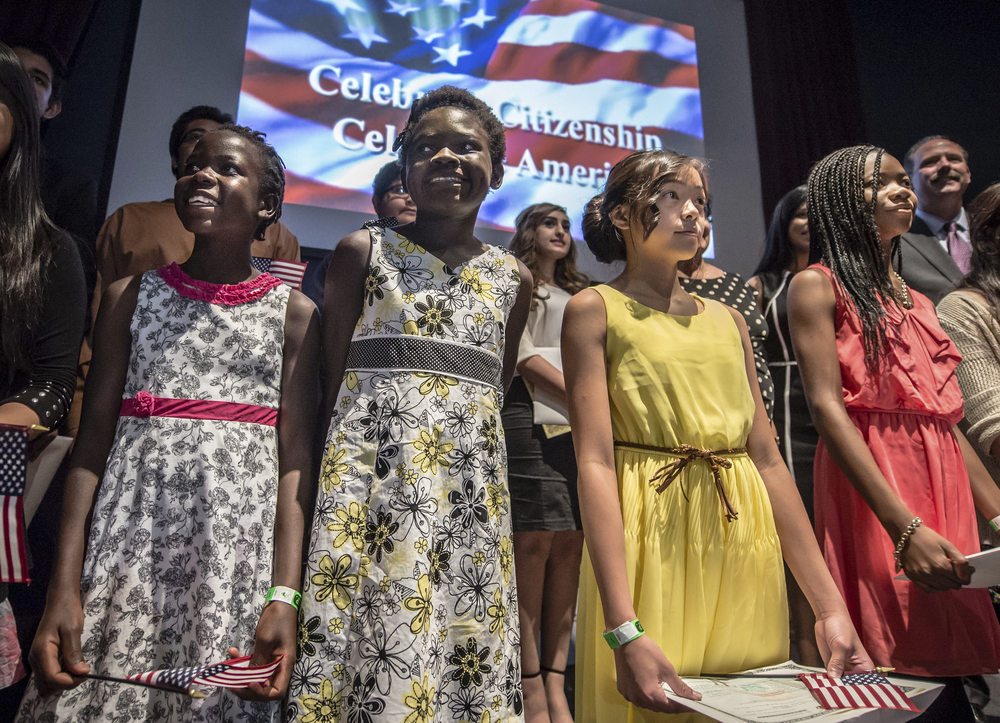 Sister from Uganda Aisha Wilging ,9,  and Flavia Wilging, 11, become U.S. citizens in a ceremony held in Albuquerque