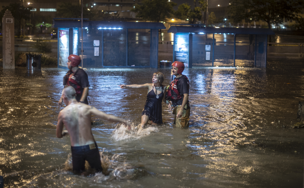 Two drivers had to be rescued by Albuquerque firefighters when their car flooded in the downtown area.