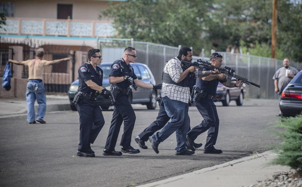Albuquerque Police officers as well as SWAT members rush a house to arrest a man who was believed to be brandishing a weapon in the southeast quadrant of the city.